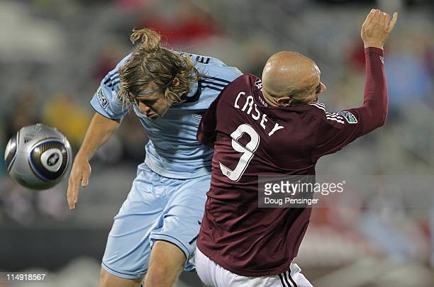 Chance Myers of the Sporting KC and Conor Casey of the Colorado Rapids collide as they battled for the ball at Dick's Sporting Goods Park on May 28...