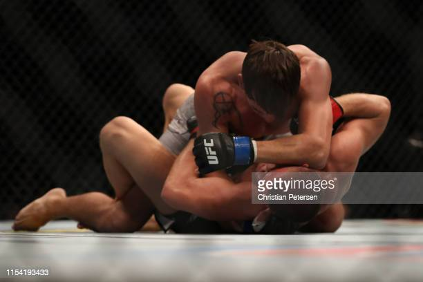 Chance Rencountre grapples Ismail Naurdiev of Austria in their welterweight fight during the UFC 239 event at TMobile Arena on July 6 2019 in Las...