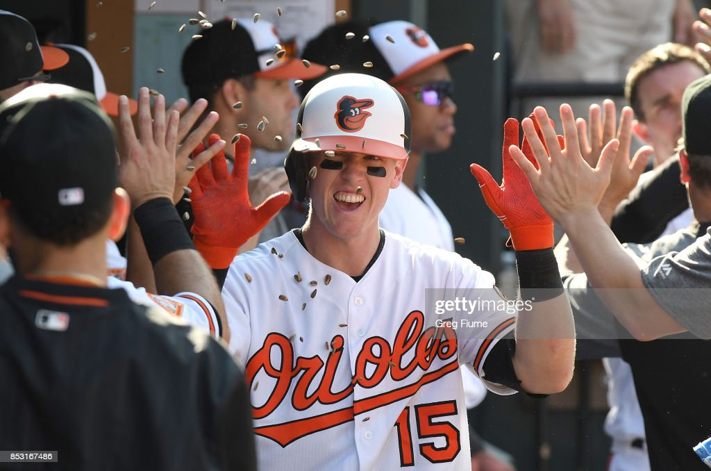 Chance Sisco #15 of the Baltimore Orioles celebrates with teammates after hitting a two-run home run in the sixth inning against the Tampa Bay Rays at Oriole Park at Camden Yards on September 24, 2017 in Baltimore, Maryland.