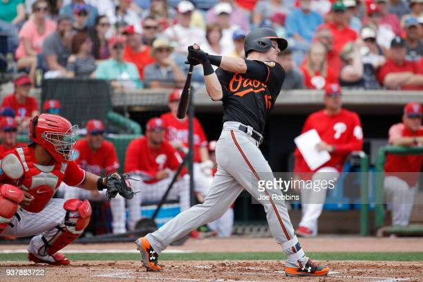 Chance Sisco of the Baltimore Orioles singles in the second inning of a Grapefruit League spring training game against the Philadelphia Phillies at...