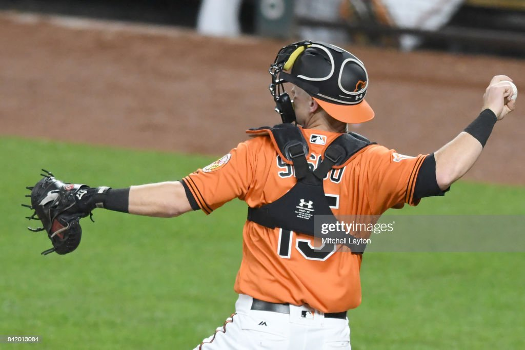 Chance Sisco #15 of the Baltimore Orioles throws to second base in his major league debut in the ninth inning during a baseball game against the Toronto Blue Jays at Oriole Park at Camden Yards on September 2, 2017 in Baltimore, Maryland.