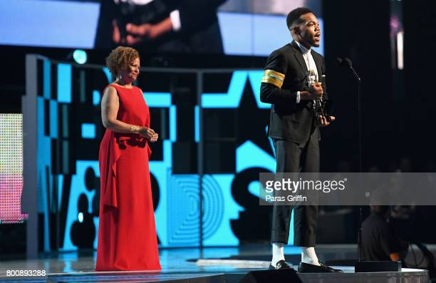 Chance The Rapper accepts the Humanitarian Award from Chairman and Chief Executive Officer of BET Debra L Lee onstage at 2017 BET Awards at Microsoft...