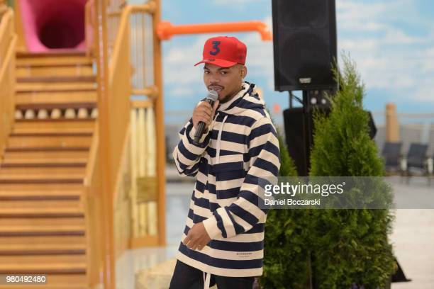 Chance the Rapper and CEO of Great Wolf Resorts Murray Hennessy press button to officially open the Great Wolf Lodge Illinois on June 21 2018 in...