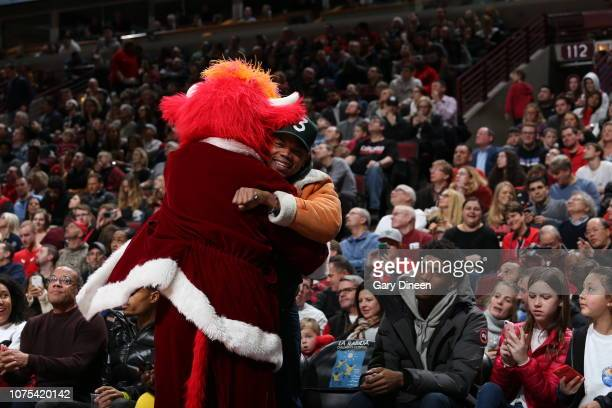 Chance The Rapper embraces Benny The Bull during the game between the Minnesota Timberwolves and the Chicago Bulls on December 26 2018 at the United...