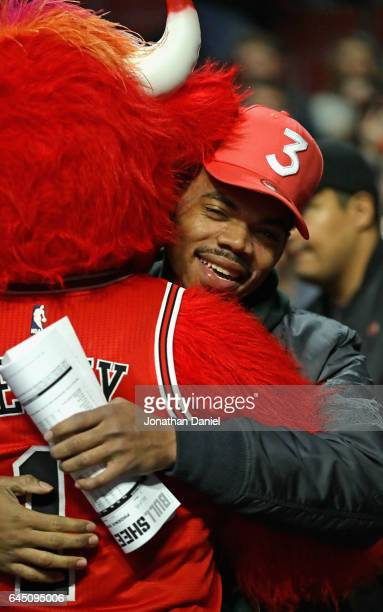 Chance the Rapper hugs Chicago Bulls mascot Benny before a game between the Bulls and the Phoenix Suns at the United Center on February 24 2017 in...