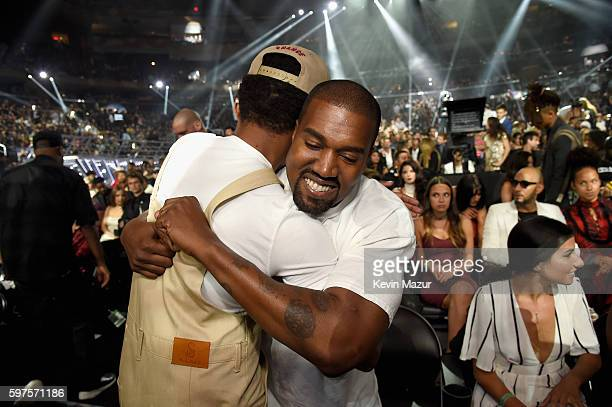Chance the Rapper hugs Kanye West during the 2016 MTV Video Music Awards at Madison Square Garden on August 28 2016 in New York City