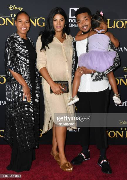 Chance The Rapper Kirsten Corley and mom attend the Premiere Of Disney's The Lion King at Dolby Theatre on July 09 2019 in Hollywood California