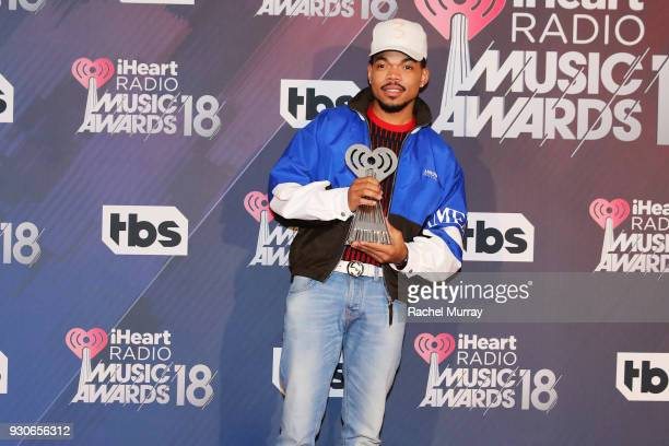 Chance the Rapper recipient of the Innovator Award poses in the press room during the 2018 iHeartRadio Music Awards which broadcasted live on TBS TNT...