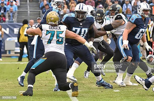 Chance Warmack of the Tennessee Titans blocks Jared Odrick of the Jacksonville Jaguars at Nissan Stadium on December 6 2015 in Nashville Tennessee