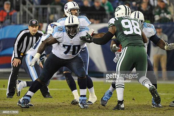 Chance Warmack of the Tennessee Titans blocks Quinton Coples of the New York Jets at LP Field on December 14 2014 in Nashville Tennessee