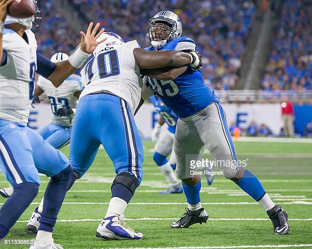 Chance Warmack of the Tennessee Titans blocks Wallace Gilberry of the Detroit Lions during an NFL game against the Tennessee Titans at Ford Field on...