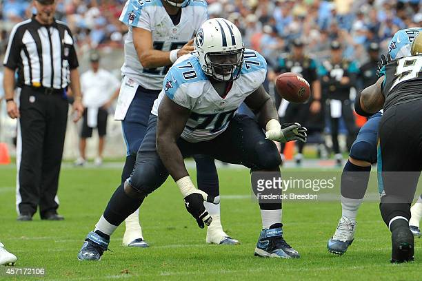 Chance Warmack of the Tennessee Titans plays against the Jacksonville Jaguars at LP Field on October 12 2014 in Nashville Tennessee
