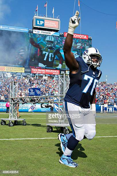 Chance Warmack of the Tennessee Titans runs onto the field before a game against the Houston Texans at LP Field on October 26 2014 in Nashville...