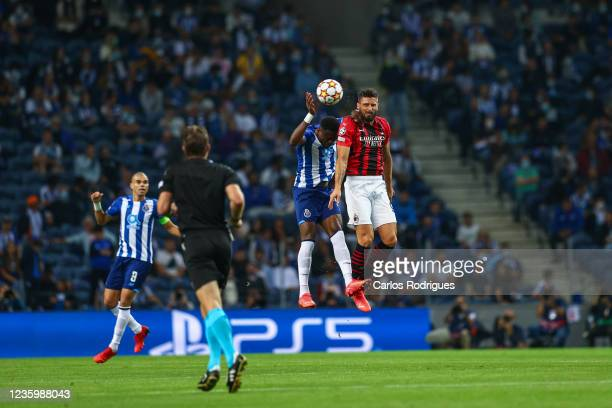 Chancel Mbemba of FC Porto vies with Olivier Giroud of AC Milan for the ball possession during the UEFA Champions League group B match between FC...