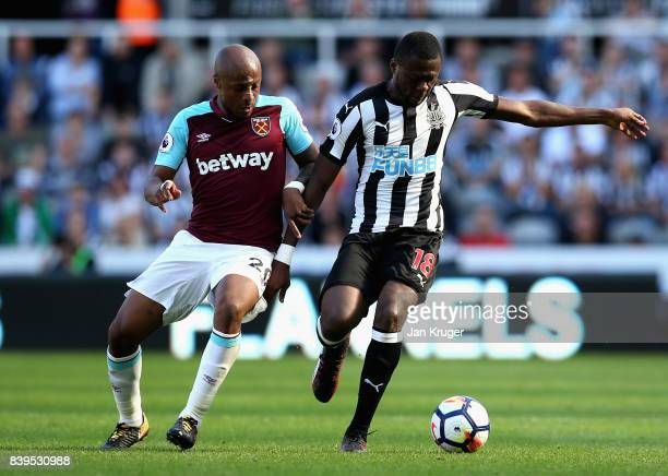 Chancel Mbemba of Newcastle United and Andre Ayew of West Ham United battle for possession during the Premier League match between Newcastle United...