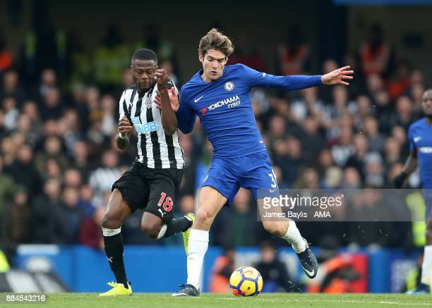 Chancel Mbemba of Newcastle United and Marcos Alonso of Chelsea during the Premier League match between Chelsea and Newcastle United at Stamford...