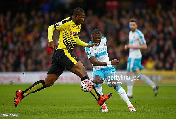 Chancel Mbemba of Newcastle United and Obbi Oulare of Watford compete for the ball during the Emirates FA Cup Third Round match between Watford and...