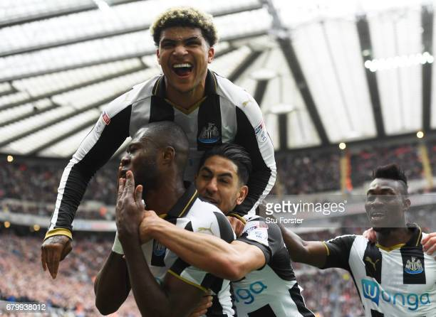 Chancel Mbemba of Newcastle United celebrates scoring his sides second goal with his Newcastle United team mates during the Sky Bet Championship...