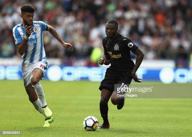 Chancel Mbemba of Newcastle United moves away from Phillip Billing during the Premier League match between Huddersfield Town and Newcastle United at...