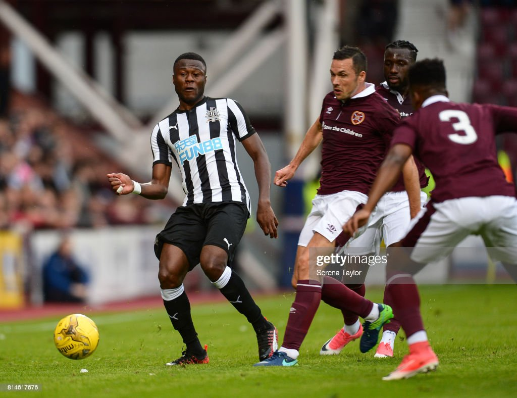 Chancel Mbemba of Newcastle United (18) passes the ball during the Pre-Season Friendly between Heart of Midlothian and Newcastle United at the Tynecastle Stadium on July 14, 2017, in Edinburgh, Scotland.