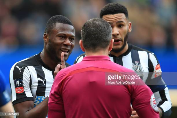 Chancel Mbemba of Newcastle United pleads with referee Kevin Friend before being shown a yellow card during the FA Cup 4th Round match between...