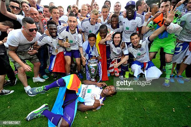 Chancel Mbemba of RSC Anderlecht jumps before team RSC Anderlecht celebrating winning the Jupiler Pro League title 2013 2014 for the 33nd time in the...
