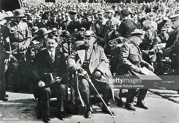 """Chancellor Adolf Hitler, President and Field Marshall Paul von Hindenburg, and Minister Hermann Goering at the Tannenberg Memorial. A year later..."
