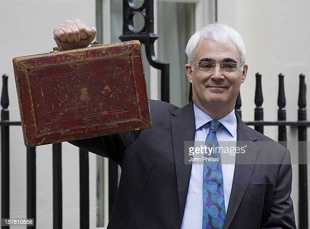 Chancellor Alistair Darling Leaves Number 11 Downing Street Before Heading To The House Of Commons To Announce The Government'S Budget Plans