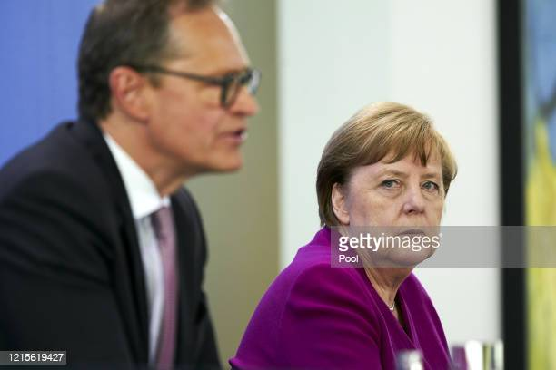 Chancellor Angela Merkel and Governing Mayor of Berlin Michael Mueller at a press briefing following a meeting with the heads of government of the...