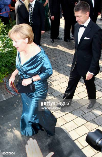 Chancellor Angela Merkel and her husband Joachim Sauer arrive for the 'Parsifal' premiere of the Richard Wagner festival on July 25 2008 in Bayreuth...