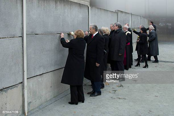 Chancellor Angela Merkel and Klaus Wowereit between others celebrits laying roses at Berlin Wall Memorial at the 25th anniversary of the fall of the...