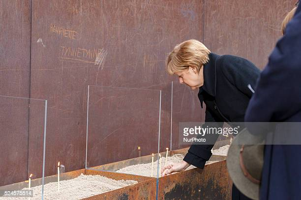 Chancellor Angela Merkel and Klaus Wowereit Governing Mayor of Berlin lighting candles at the National Memorial for the Victims of the Berlin Wall to...