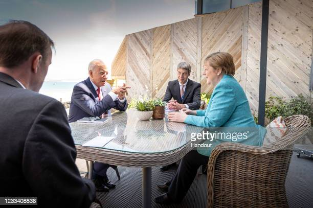 Chancellor Angela Merkel and US President Joe Biden at the beginning of their conversation on the sidelines of the G7 summit in St. Ives, together...