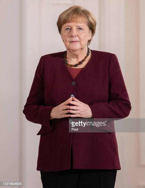 Chancellor Angela Merkel attends as Oezlem Tuereci and Ugur Sahin, founders of Biontech SE, receiving the Federal Order Of Merit from President...