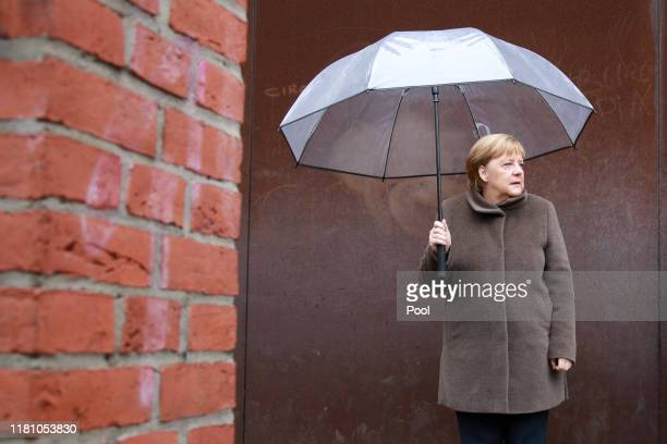 Chancellor Angela Merkel attends the commemoration of the Berlin Wall Foundation on Bernauer Strasse during the 30th anniversary celebrations of the...