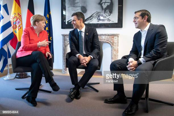 Chancellor Angela Merkel in conversation with Spanish Prime Minister Pedro Sanchez and Greek Prime Minister Alexis Tsipras at the beginning of the...