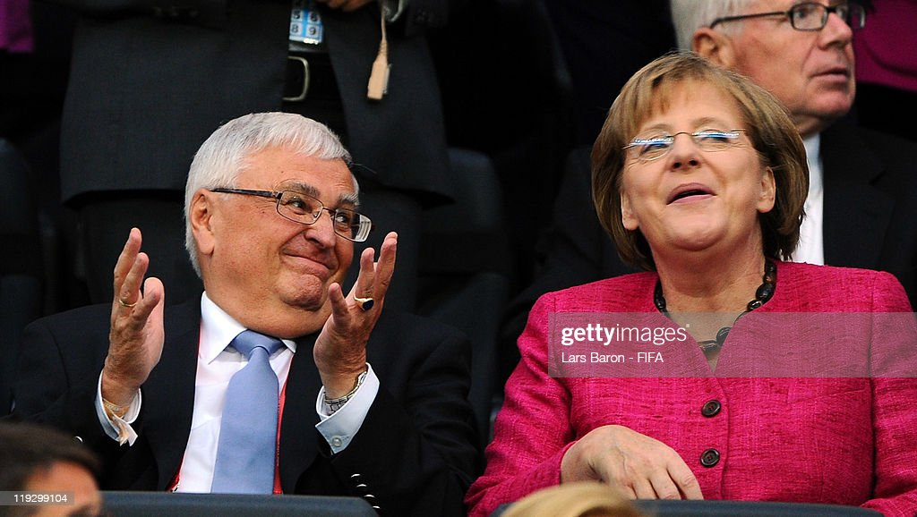 Chancellor Angela Merkel of Germany smiles next to Theo Zwanziger, president of German Football Association, during the FIFA Women's World Cup Final match between Japan and USA at the FIFA Women's World Cup Stadium on July 17, 2011 in Frankfurt am Main, Germany.