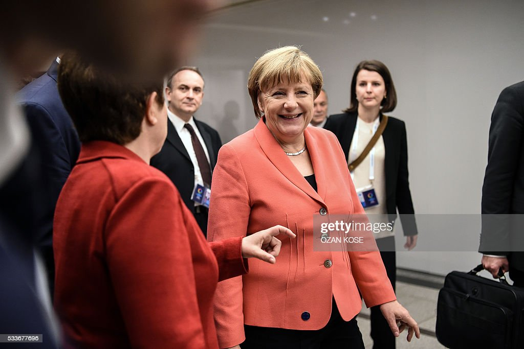 Chancellor Angela Merkel (C) smiles on May 23, 2016 as she leaves the World Humanitarian Summit family photo session in Istanbul. The over 60 heads of state and government gathered for the two-day summit convened by UN Secretary General Ban Ki-moon will have to defeat considerable scepticism that the event will turn into a well-intentioned but fruitless talking shop. KOSE