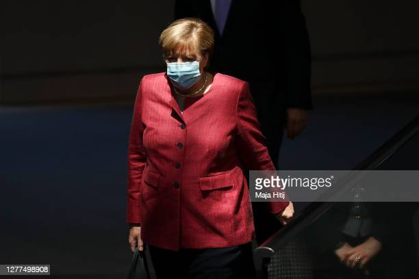 Chancellor Angela Merkel wears a protective mask as she arrives at the Bundestag on September 30, 2020 in Reichstag building in Berlin, Germany.