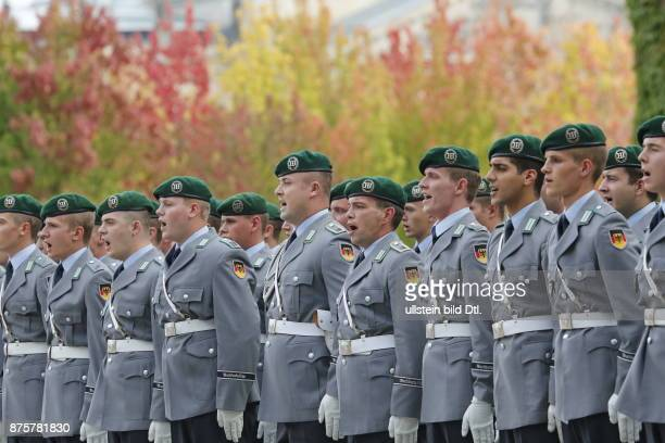 Chancellor Angela_Merkel welcomes the Prime Minister of Finland Alexander_Stubb with military honors on September 29 2014 in the Federal Chancellery...