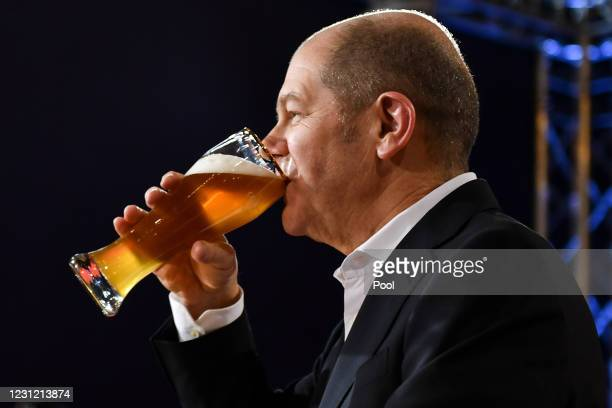 Chancellor candidate of the German Social Democrats and German Minister of Finance Olaf Scholz enjoys a beer at the Political Ash Wednesday gathering...
