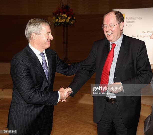 Chancellor candidate of the German Social Democrats Peer Steinbrueck and Deutsche Bank coChairman Juergen Fitschen chat at a podium discussion at the...