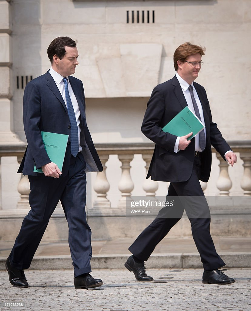 Chancellor George Osborne and Chief Secretary to the Treasury Danny Alexander (R) leave the Treasury for the House of Commons where the Chancellor will deliver this year's spending review speech on June 26, 2013 in London, England.