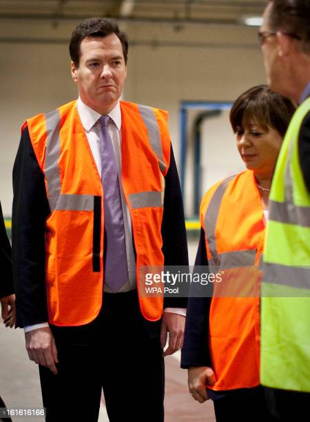 Chancellor George Osborne and Conservative candidate Maria Hutchings wear high visibility jackets as they make a visit to the Prysmian Group factory...