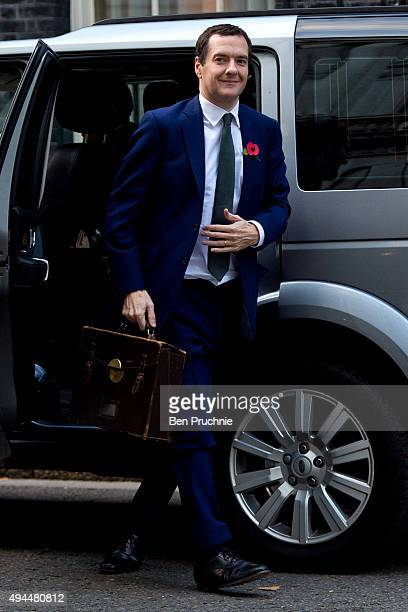 Chancellor George Osborne arrives at Downing Street on October 27 2015 in London England Today Chancellor George Osborne promised to bring tax credit...
