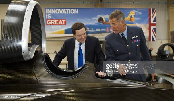 Chancellor George Osborne is shown the cockpit of land speed record car Bloodhound by Wing Commander Andy Green during a visit to the Bloodhound...