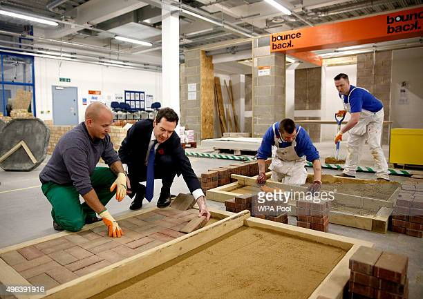 Chancellor George Osborne lays a brick in a blockpaving demonstration during a visit to Brixton Prison on November 09 2015 in London England The...