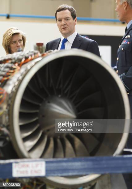 Chancellor George Osborne looks at the jet engine of land speed record car Bloodhound during a visit to the Bloodhound Technical Centre at Avonmouth...