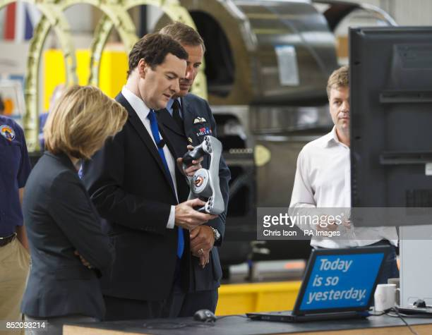 Chancellor George Osborne looks at the steering wheel of land speed record car Bloodhound during a visit to the Bloodhound Technical Centre at...