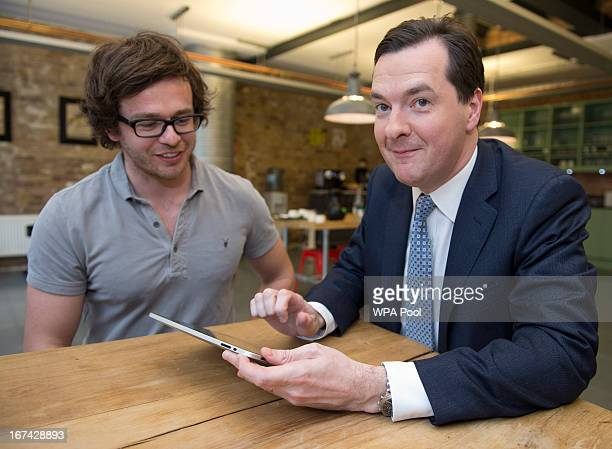 Chancellor George Osborne plays Capture an internet security game as Howard Kingston the game's creator and cofounder of Future ad Labs looks on at...